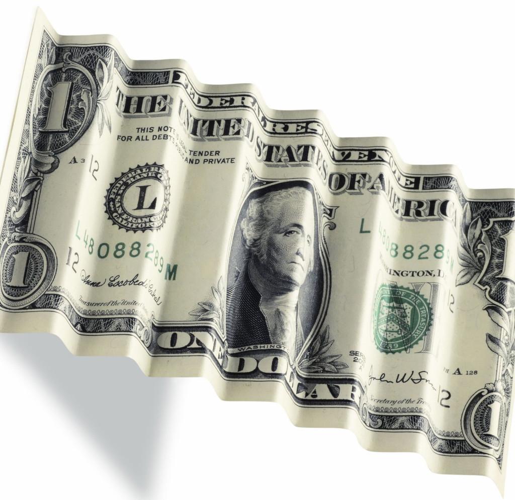 NFP rozczarowały. Dolar z potężnym ciosem. Złoto w górę - banknot dolarowy złożony w harmonijkę